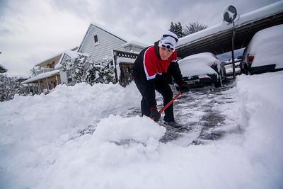 Josh Davis of Port Angeles clears a foot of snow out of his driveway on Wednesday, Jan. 15, 2020. Areas near downtown Port Angeles saw more than a foot of snow overnight. (Jesse Major)