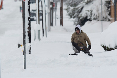 Alex Lopez of Creative Landscaping in Port Angeles uses a snow blower to clear the sidewalk of snow on Wednesday, Jan. 15, 2020. (Jesse Major)