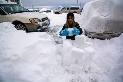 Isabella Olvera of Port Angeles, 11, builds a small igloo Wednesday, Jan. 15. 2020. (Jesse Major)