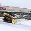 A plow works on clearing the Wallace Plaza on John Fitch Highway during the storm on Tuesday February 7, 2017. SENTINEL & ENTERPRISE/JOHN LOVE