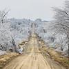 A crippling ice storm brings down large tree limbs along a rural road near Henryetta, OK, on December 22, 2013.