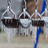 Freezing rain encases swings at a playground in Norman, OK, after a major ice storm on December 21, 2013.