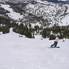yunmei snowboarding down the slope.