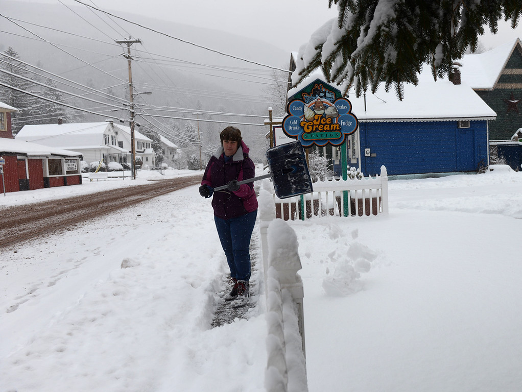 . Tania Barricklo- Daily Freeman  Robin Kirk, owner of The Nest Egg and the Ice Cream Station on Main St. in Phoenicia , shovels her section of hte sidewalk Wednesday morning after upwards of 7 inches of snow fell overnight.