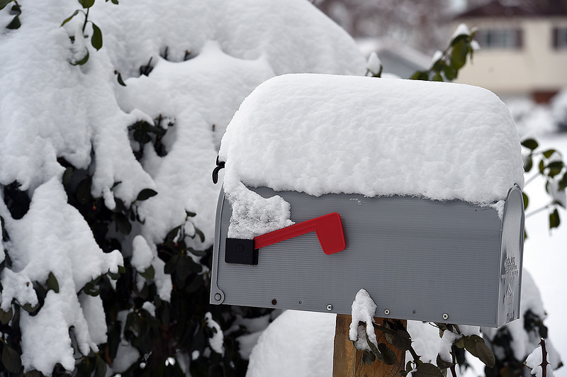 Snow is stacked on a mailbox in west Loveland on Thursday, Dec. 5, 2017. (Photo by Jenny Sparks/Loveland Reporter-Herald)