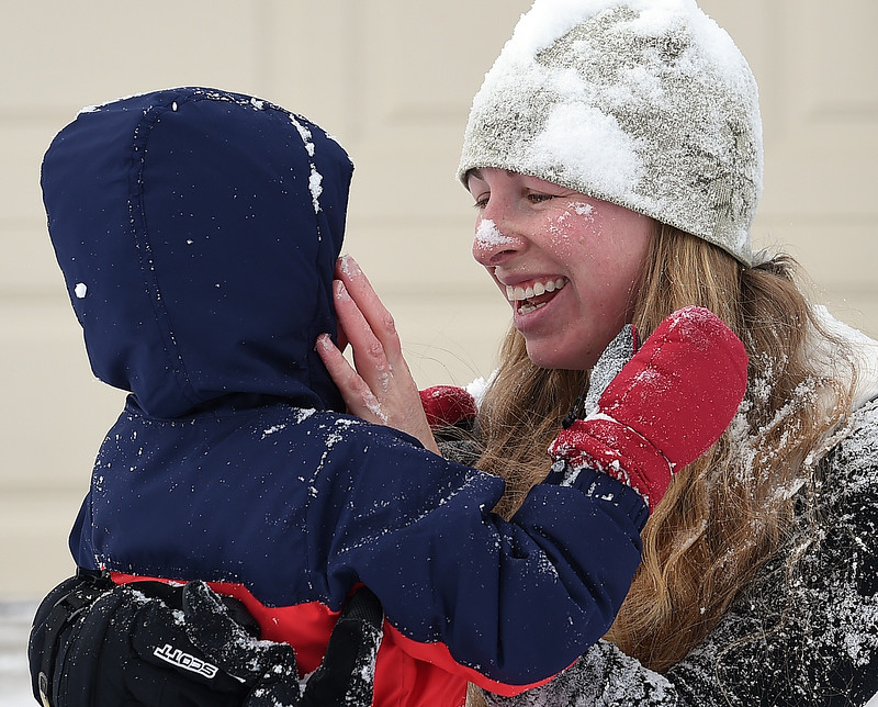 Miriam Veigel wipes snow off of her three year-old son, William Veigel's face after playing in the snow Thursday, Jan. 5, 2017, on the 1900 block of Estrella Avenue in west Loveland. (Photo by Jenny Sparks/Loveland Reporter-Herald)