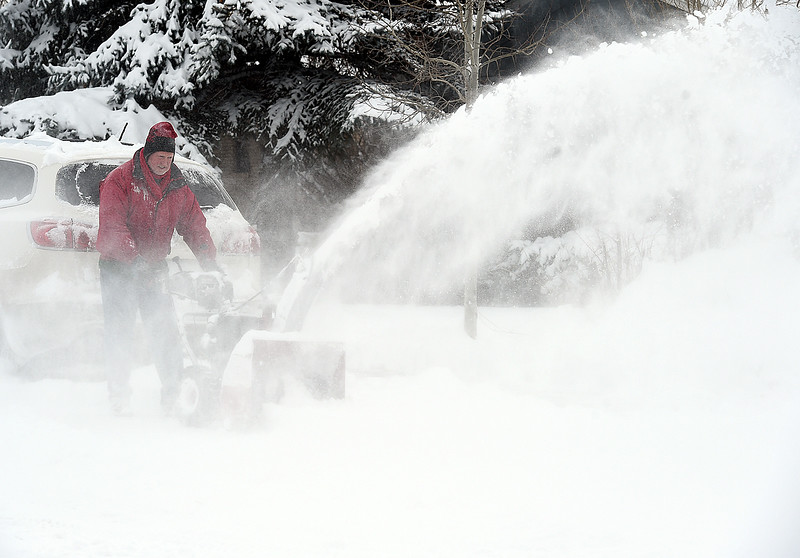 Ed VanDyne uses a snowblower to clear snow in front of his Loveland home on the 2500 blcok of Farisita Drive. (Photo by Jenny Sparks/Loveland Reporter-Herald)