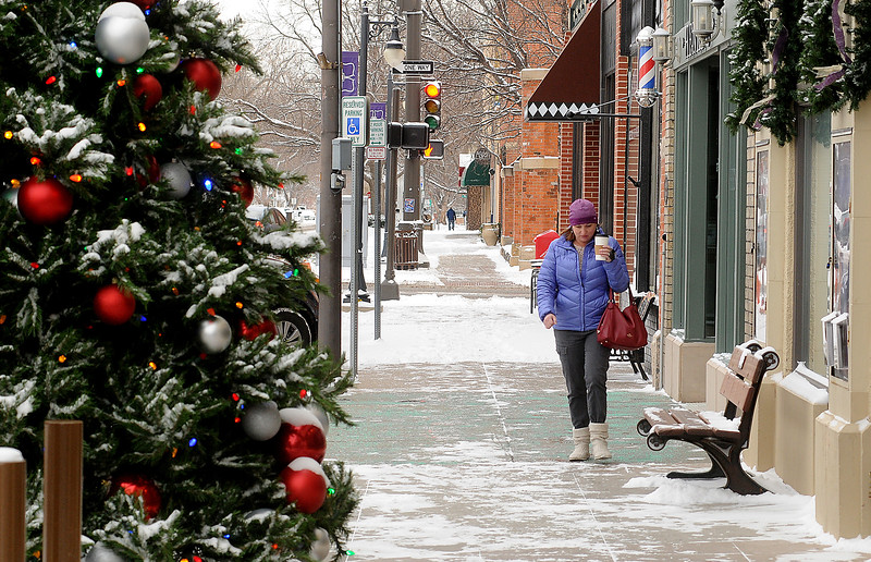 Fort Collins resident Kari Barnum makes her way back to her car in single-digit weather Wednesday morning, Dec. 7, 2016, after running an errand on Fourth Street in downtown Loveland. (Photo by Craig Young / Loveland Reporter-Herald)