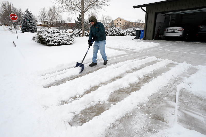 "Robert Young shovels snow from the driveway of his Loveland home on the 1900 block of Caddoa Drive in Loveland on Wednesday, Dec. 7, 2016. Talking about how he was recently married and that he and his wife just moved into this home Young said with a smile ""This is my first time clearing snow at this house. This is also my first time clearing snow as a married man. It sure is a beautiful morning!"" (Photo by Jenny Sparks/Loveland Reporter-Herald)"
