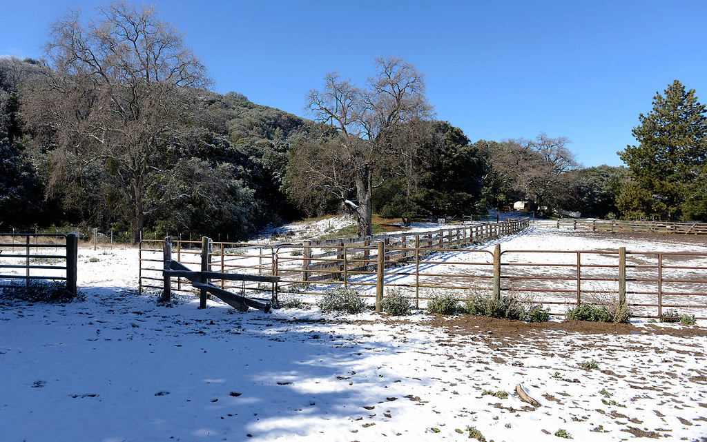 . Snow covered corral at the Nason Ranch on Tassajara Road in Carmel Valley on Tuesday, Feb. 27, 2018.  (Vern Fisher - Monterey Herald)