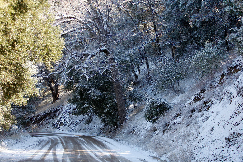 . Fresh snow covers Tassajara Road in Carmel Valley on Tuesday, Feb. 27, 2018.  (Vern Fisher - Monterey Herald)