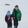 JENN SMITH — THE BEKRSHIRE EAGLE <br /> Tate Carothers, 10, walks Patrick Brody, 3, up a snowy hill at Taconic Golf Club in Williamstown on Monday. Monday, December 2, 2019