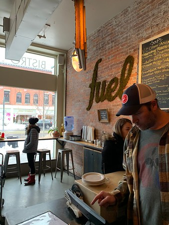 HEATHER BELLOW — THE BERKSHIRE EAGLE<br /> Fuel Bistro and Coffee Shop owner Will Curletti helps customers Monday morning at his Main Street, Great Barrington eatery, while a light snow flurries between storms.