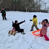 HEATHER BELLOW — THE BERKSHIRE EAGLE<br /> Park Street Park in Great Barrington was popular Monday for sledding and snowball fights. From left, Emily DeVoti, Eason Zhang, Fionn DeVoti Roland and Eaxin Zhang.
