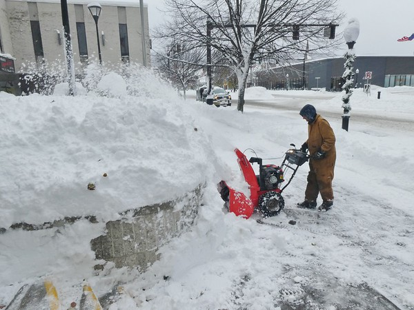 JENN SMITH — THE BEKRSHIRE EAGLE <br /> With few options of where to put the snow, Matt Sherman of A1 Incorporated piles it high into a pavilion outside some Main Street businesses in North Adams on Monday. Monday, December 2 2019