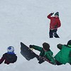 JENN SMITH — THE BEKRSHIRE EAGLE <br /> Cade Morrell,11, winds up with a snowball as, from left, Patrick Brody, 3, Tate Carothers, 10, and Nate Brody, 11, brace themselves at Taconic Golf Club in Williamstown. Monday, December 2, 2019