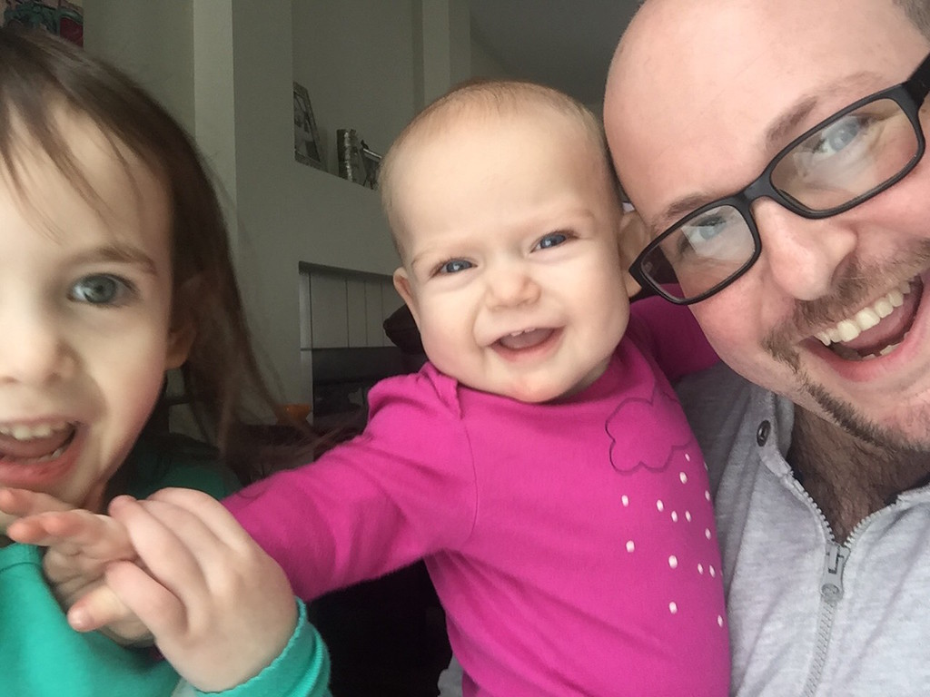 . Ben Kalish, of West Bloomfield, with daughters Parker, 3, and Isabelle, 9 months, enjoying their snow day while cozy indoors. Submitted photo