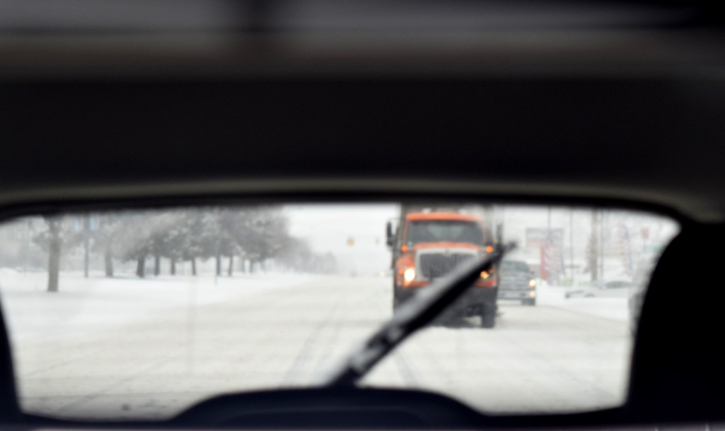 . The only thing scarier than not being able to find a lane on the road is seeing a snowplow blazing its own trail directly behind you, as this one was on Gratiot Avenue in Mt. Clemens. Gina Joseph / Macomb Daily.