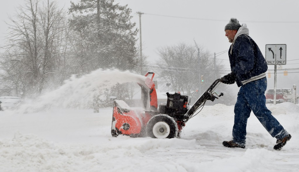 . Moving the snow in Waterford late Friday morning, Feb. 9, 2018. Photo by Natalie Broda / The Oakland Press.