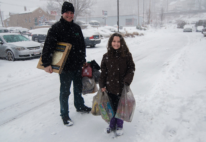 Aaron Meade and Kaylee Halagich, 8, stock up on groceries during the storm on Thursday, February 9, 2017. SENTINEL & ENTERPRISE / Ashley Green