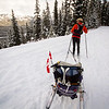 <b>8 Nov 2013</b> Moraine Lake Road - taking it in turn to tow a sleeping Finn.  Who is MUCH heavier these days.