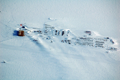 SOUTH POLE, ANTARCTICA: It's such a tease. That's where we want to go, but it's too cold to land. You can just make out the skiway running across the frame right along the length of the station complex.