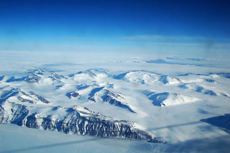 ANTARCTICA: The last of the the Trans-Antarctic Mountains as we approach the Antarctic plateau in the center of the continent. Can you tell what that dark line is going across the image?