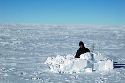 SOUTH POLE, ANTARCTICA: Pete satisfies his urge to dig a hole in the snow. Little did he know there was plenty of shoveling to do back at the station.