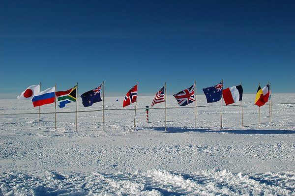 SOUTH POLE, ANTARCTICA; It wasn't until my third day here that I actually made a visit out to the specific point of the South Pole. This is the ceremonial South Pole, with the flags of the founding nations of the Antarctic Treaty.