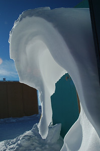 SOUTH POLE STATION, ANTARCTICA: Snow Formation. This was once a strip of snow up along the building side, but the sun has caused it to slowy soften and peal away... looks like a sea horse.
