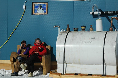 SOUTH POLE STATION, ANTARCTICA: Come mid summer and it's absolutely sizzling outside. Why not sit out on a nice bench... next to a fuel tank?