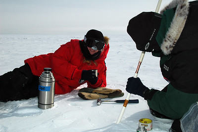 SOUTH POLE STATION, ANTARCTICA: Randi enjoys some cider while Kris adds another extension onto a short stake.