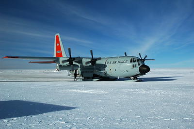 SOUTH POLE STATION, ANTARCTICA: The LC-130 Hercules gets plugged into the fuel system and offloads the fuel it can spare for the winter.