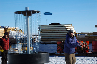 SOUTH POLE STATION, ANTARCTICA: Chuck watches as Jason makes a bid for the 'hole' - our homemade version of a goal.