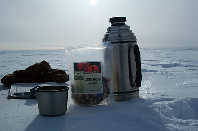 SOUTH POLE STATION, ANTARCTICA: A little Antarctic snack while out measuring snow stakes.