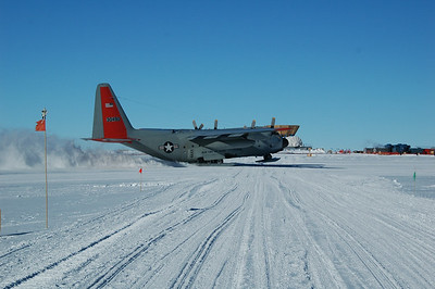 SOUTH POLE STATION, ANTARCTICA: LC-130 take off over the road to the dark sector.