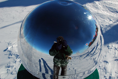 SOUTH POLE, ANTARCTICA; Self portrait at the ceromonial South Pole. The snow on me is from rolling around in the snow to try to get some interesting angles for the photos.