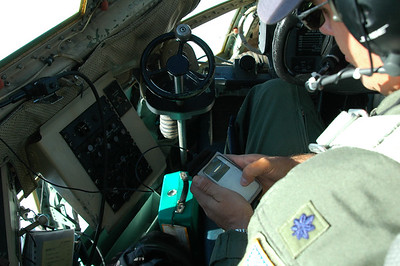 ANTARCTICA: Of course the pilot can't do with out some tunes from his iPod that is piped into his radio headset.