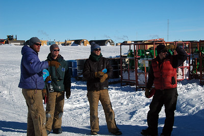 "SOUTH POLE STATION, ANTARCTICA: On New Years Eve Day, a game of Frisbee Golf was organized. Of course each ""hole"" is not obvious so it has to be pointed out and discussed."
