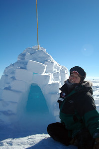 SOUTH POLE, ANTARCTICA: Elyssa hangs out in front of an ingloo that was built by the previous group that came out here to camp.
