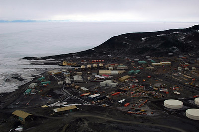 MCMURDO STATION, ANTARCTICA: Looking down from Observation Hill onto the sprawling metropolis of McMurdo Station. Notice the ice breaker in the port? He's under repair.