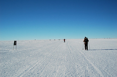 SOUTH POLE STATION, ANTARCTICA: Once on the skiway, the going was pretty straight forward. Our fearless leader, Chris waits ahead while Kari skis towards him.