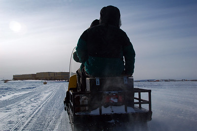 SOUTH POLE STATION, ANTARCTICA: The plane gets off the skiway and onto the taxiway, the beacon goes off and we're back on the snowmobile and the sled it's towing to get back to the station.