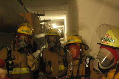 SOUTH POLE, ANTARCTICA: The group pauses for a moment to check in with everyone and to discuss what sort of dangers might be encountered when trying to perform a rescue in these tunnels. The fire brigade is the only group with the use of the SCBA units, so even if there isn't a fire (come on.. these are SNOW tunnels!) there is the possibility that noxious gases could fill the tunnels and only SCBA equipped personnel will be able to get in there to get someone out.