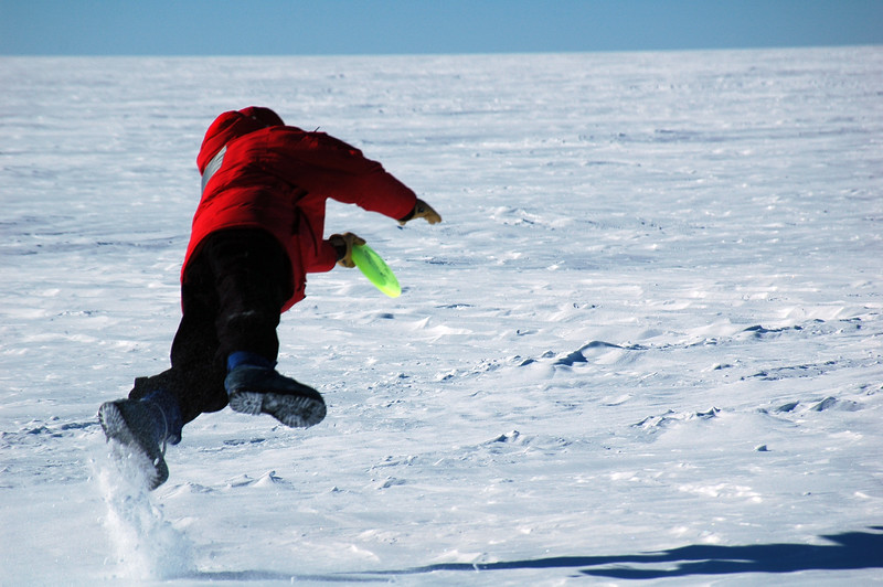 SOUTH POLE, ANTARCTICA: Niel takes a flying leap to snag a throw that is nearly out of reach.