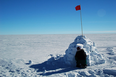SOUTH POLE, ANTARCTICA: After Elyssa crawls in, Kari comes over to check the igloo out.