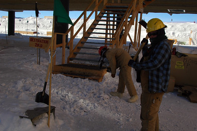 SOUTH POLE STATION, ANTARCTICA: The labor continues. Derick and Jill (r.) pound up the snow at the stairs to keep folks from slipping.