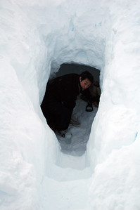 SOUTH POLE, ANTARCTICA: Kuwon slept soundly in his snow trench and finally emerges, oblivious that much of the gang has already been up for a while.
