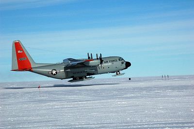 SOUTH POLE STATION, ANTARCTICA: The wings flex up and finally pull the rest of the aircraft off the snow and into the sky.