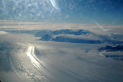 ANTARCTICA: A river of ice creaps down from the upper plateau and merges with another flow.